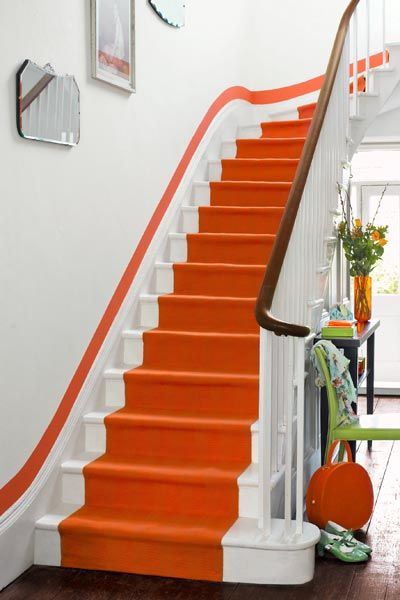 stairs, white stairs, orange carpet, orange line on white wall