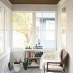 Sunroom, Grey Floor, White Textured Wall, White Shelves, Rattan Bench With Shite Cushion, Large Glass Window