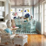 Turquoise Wooden Dining Set, Wooden Floor, Blue Wall, White Rattan Chair, White Rattan Stools, White Table Lamp