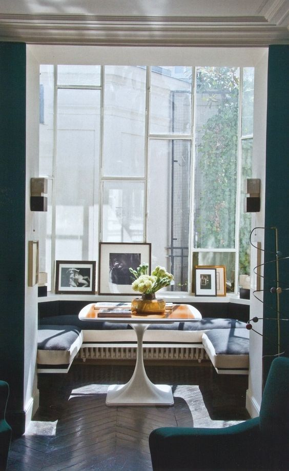 window nook, wooden chevron floor, black floating bench, wooden table, glass window