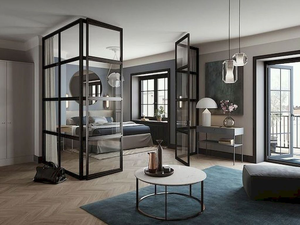 apartment, brown floor, grey wall, round table, blue rug, pendants, glass partition, grey bed, round mirror