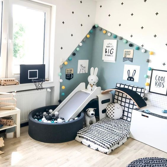 baby room, wooden floor, white wall, blue wall, white cushion, black round box, slide