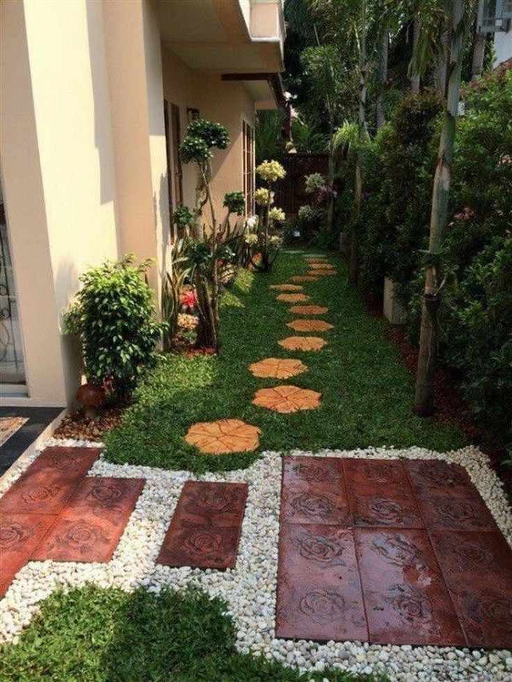 back yard, grass, white stones, stepping tiles, plants