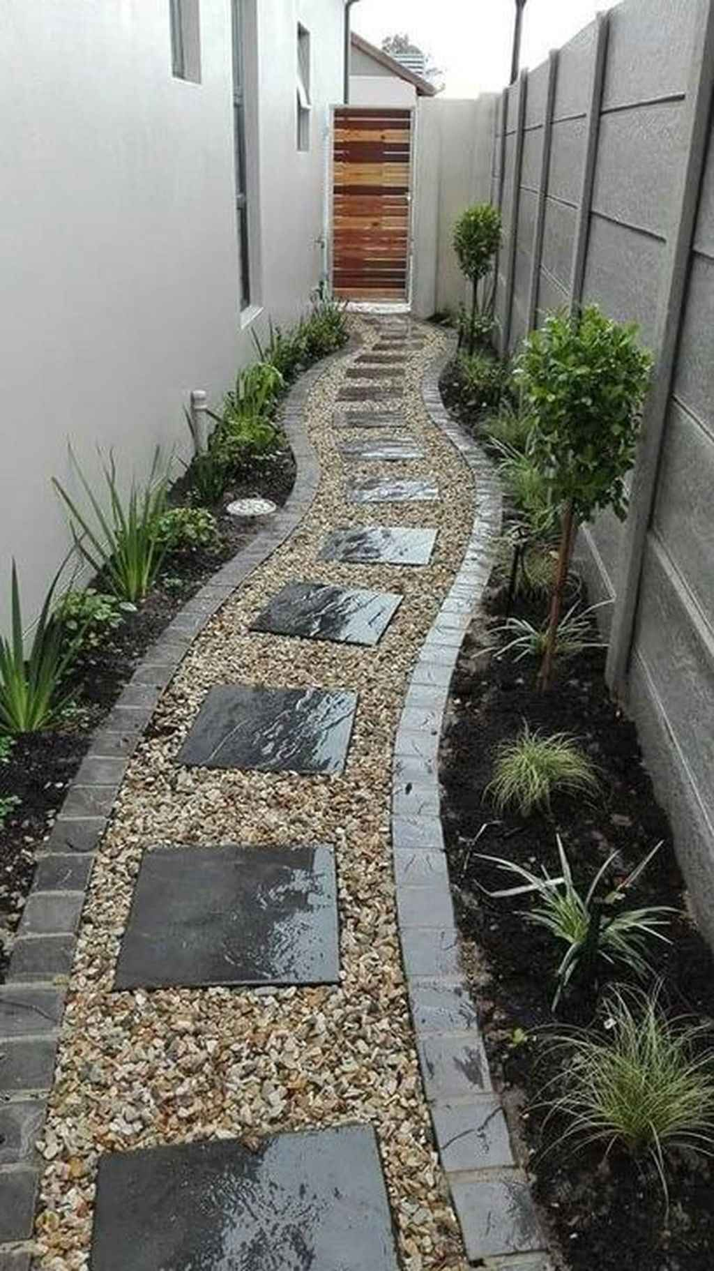 back yard, stones, black granite, white wall, plants