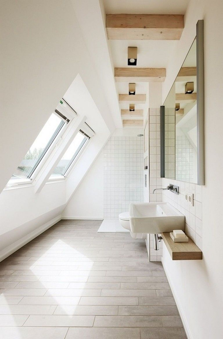 bathroom, brown floor tiles, white wall, white wall tiles, floating vanity, white sink, white toilet