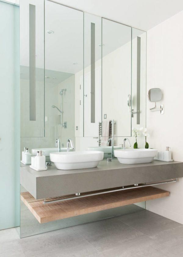 bathroom, grey floor, grey floating table vanity, white sinks, white wall, mirror
