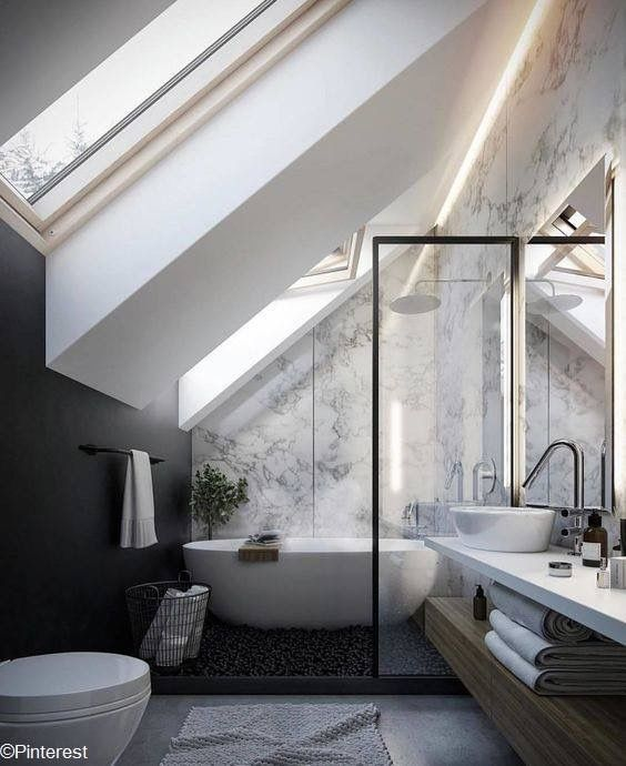 bathroom, grey floor, grey marble wall, black wall, white vaulted children, wooden vanity, white vanity with white sink, white toilet, glass partition