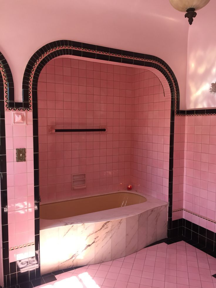 bathroom, pink tub, pink wall tiles, pink floor tiles, black tiles