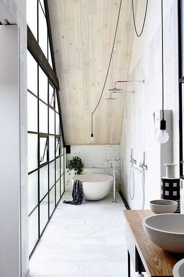 bathroom, white floor, white wall, shower faucets, bulb pendant, white tub, wooden vanity table, grey sinks
