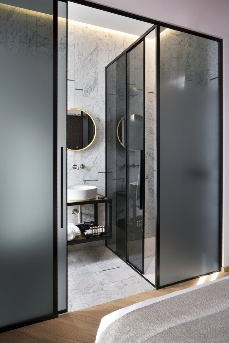 bathroom, white marble floor, white marble wall, black glass wall