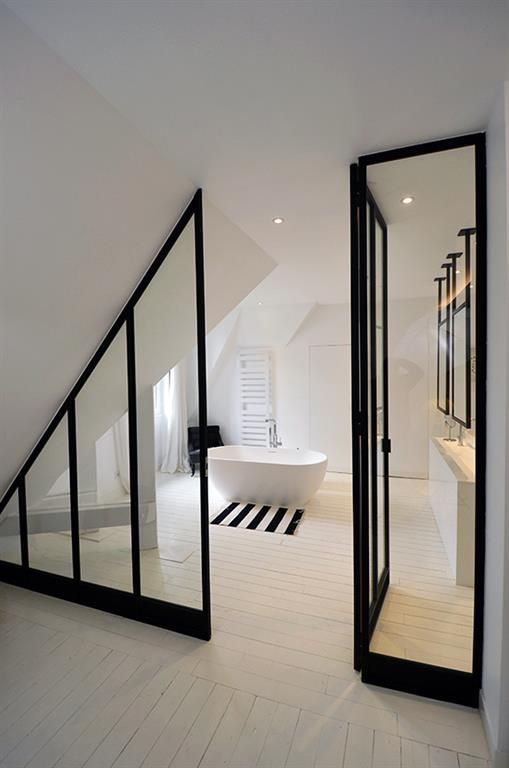 bathroom, white wooden floor, white tub, glass partition, white vanity