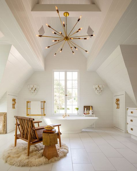 bathroom, white wooden floor, white vaulted ceiling, modern chandelier, white tub, white cabinet, wooden chair