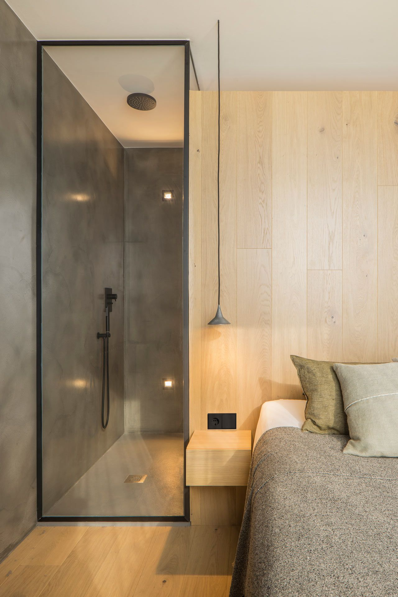 bathroom, wooden floor, grey wall, wooden wall, wooden floating sidde table, glass door, grey pendant