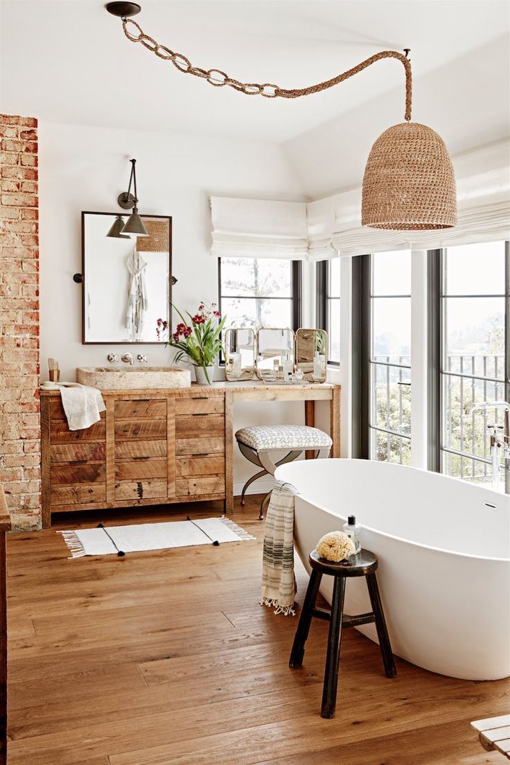 bathroom, wooden floor, white wall, rattan pendant, white rub, wooden vanity cabinet, pink marble sink, white curtain,