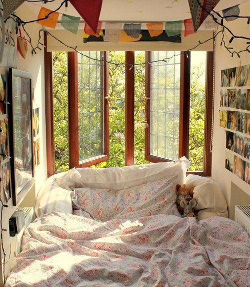 bed inside a nook, brown wooden framed window