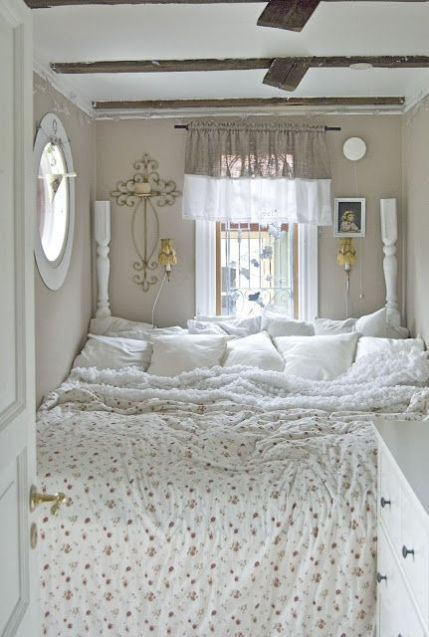bed nook, curtain, round window, white cabinet