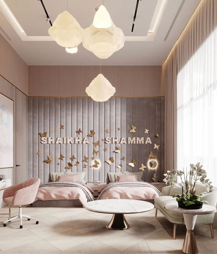 bedroom, pink wall, grey headboard, white lantern pendants, white round coffee tbale, white sofa, white rug
