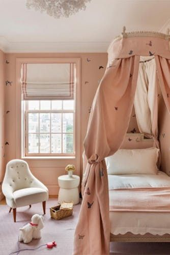 bedroom, pink wall, pink curtain, white chair, white side table, chandelier