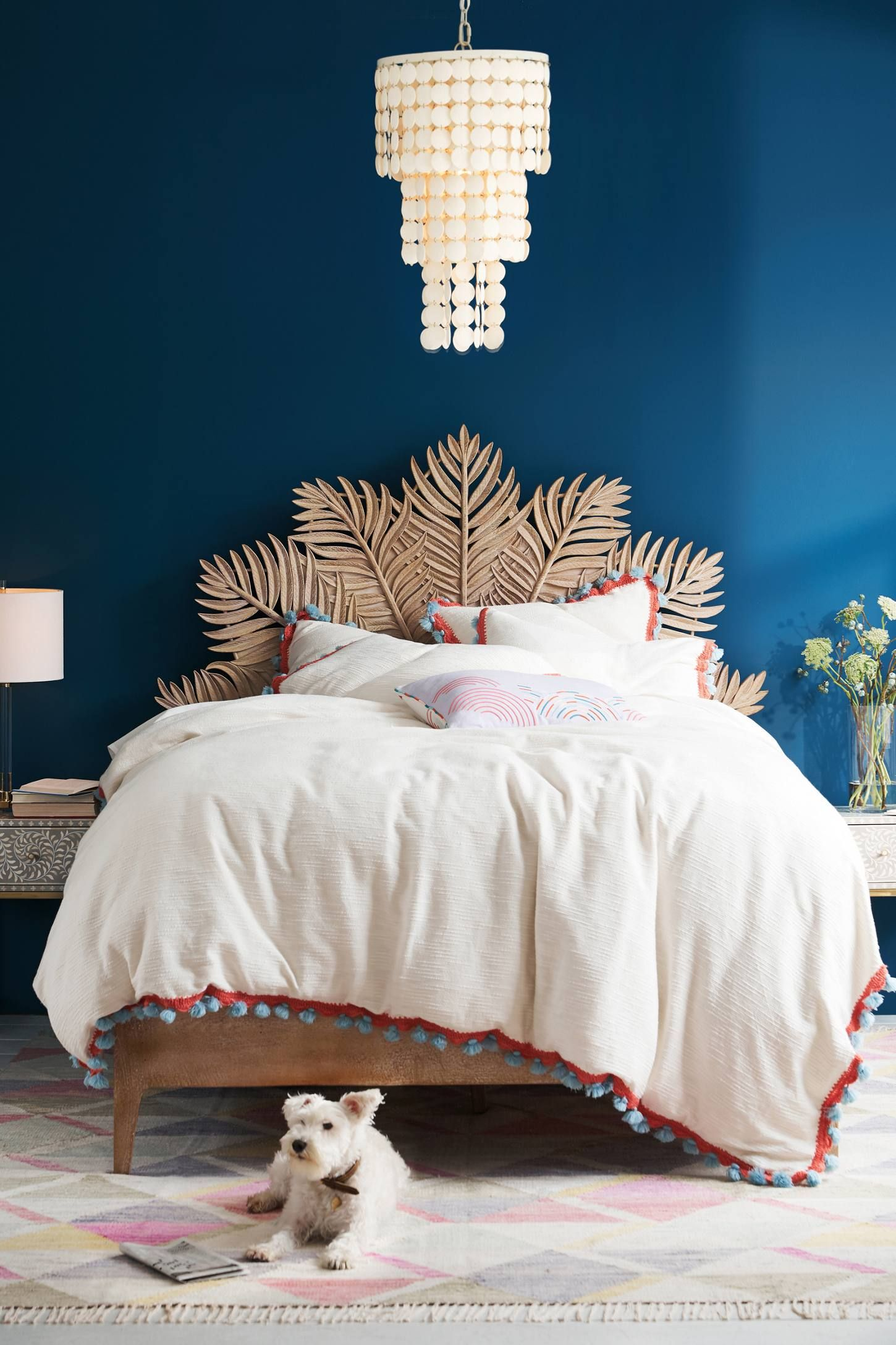 bedroom, soft colorful rug, blue wall, leaves headboard, white shells pendant, side table