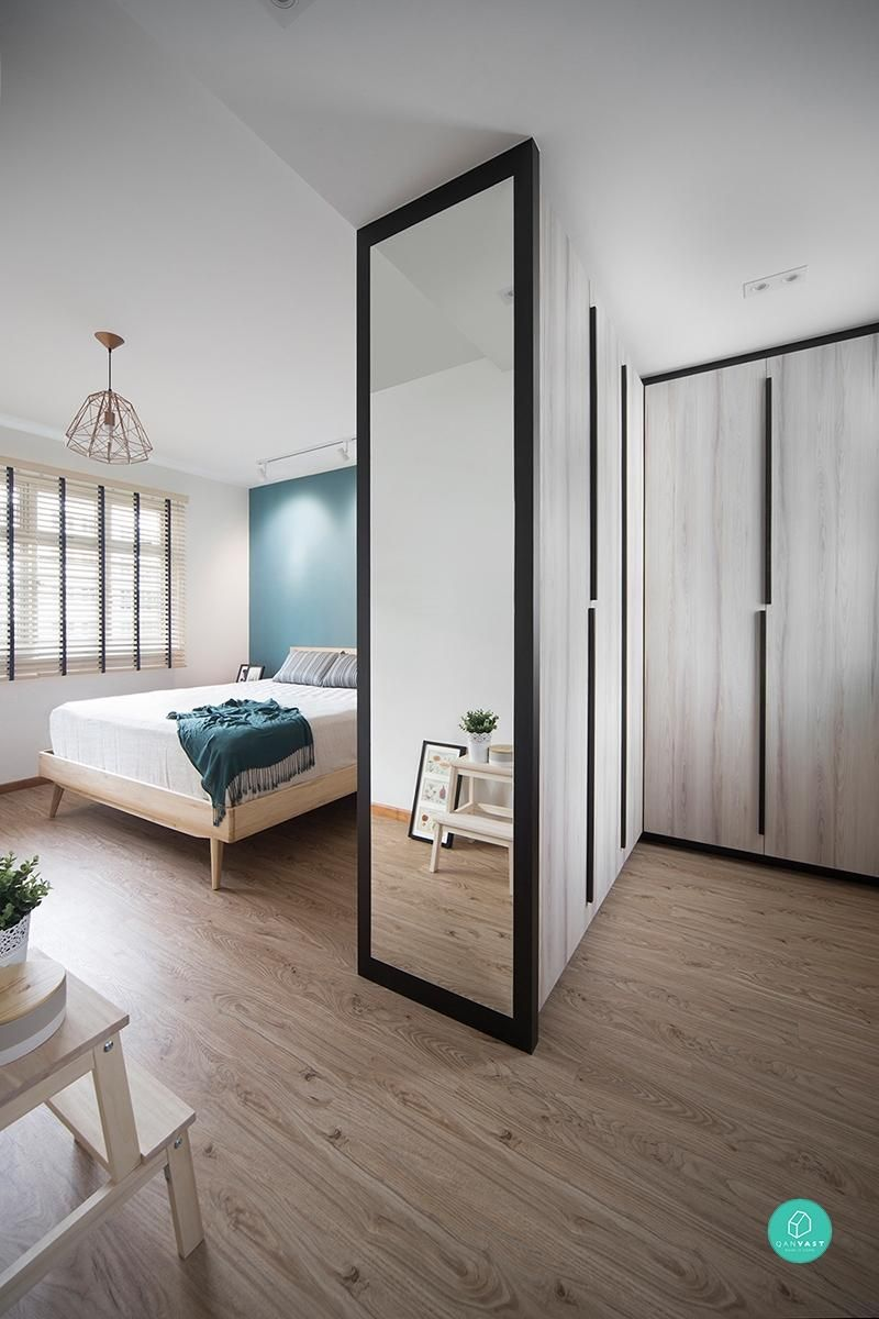 bedroom, wardrobe, wooden floor, white wall, wooden bed platform, blue accent wall, pendant