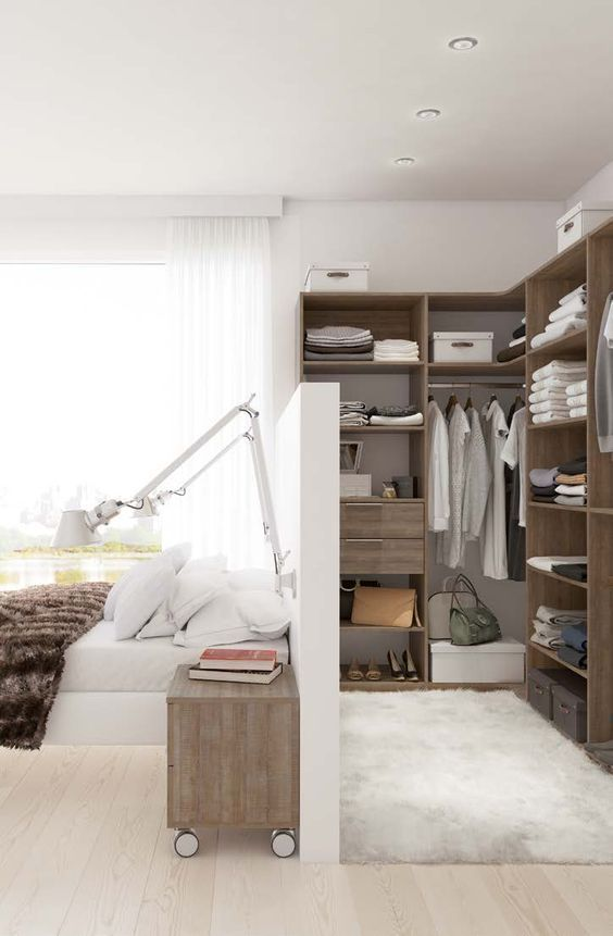 bedroom, white wooden floor, white rug, wooden shelves, white partition, wooden side table, white sconces