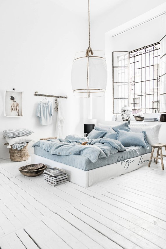 bedroom, white wooden floor, white wall, white bed platform, blue bedding, white pendant, glass window
