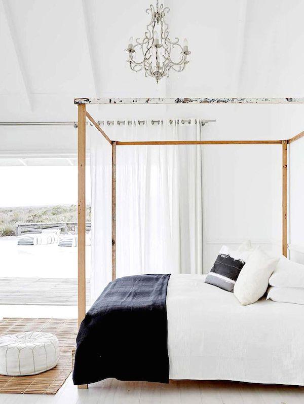 bedroom, white wooden platform, white wall, wooden bed platform, chandelier