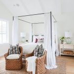 Bedroom, Wooden Floor, White Wall, Rattan Rug, Rattan Chairs, Black Poles With White Curtain, White Side Console Table