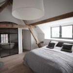 Bedroom, Wooden Floor, White Wall, Vaulted Ceiling, Black Bed Platform, Wooden Beams