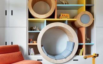 bookshelves, colorful boards, white cabinet, round indented spacein the shelves to sit