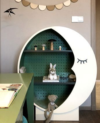 bookshelves, round, white, green back, black boards, white moon shape
