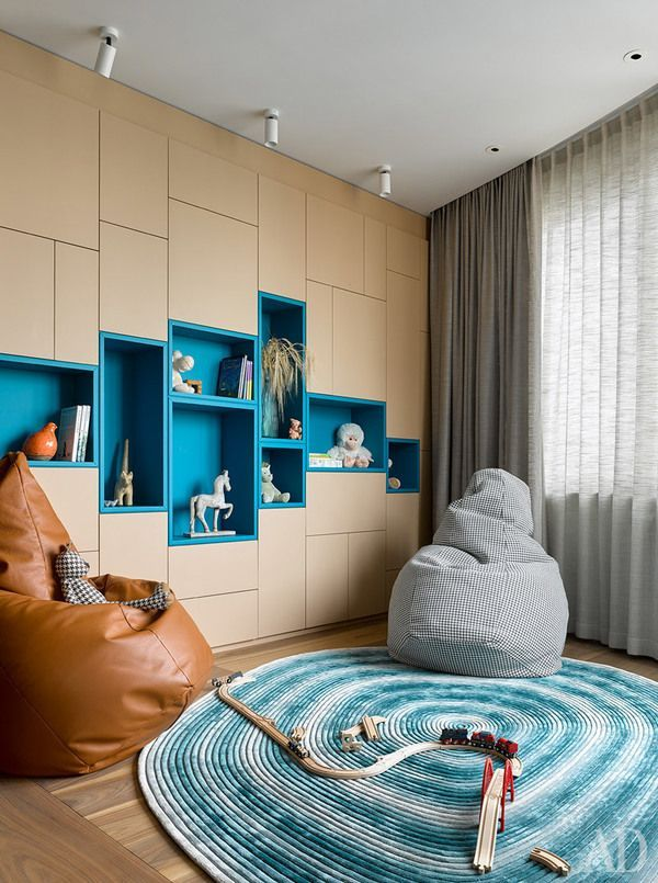brown cabinet with blue background shelves,