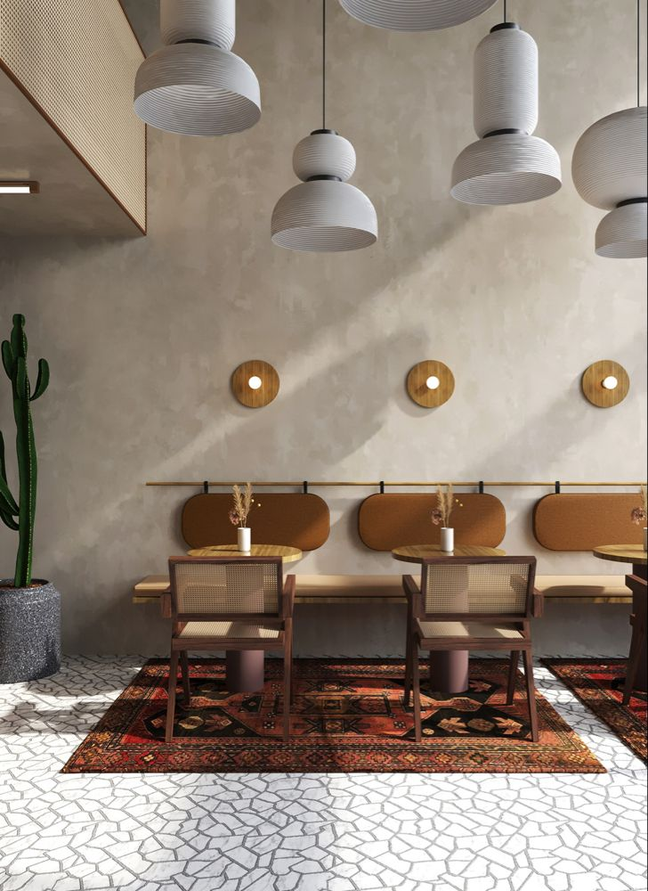 cafe, white patterned floor, grey seamless wall, grey pendants, wooden floating bench, brown back, wooden chairs with rattan seat