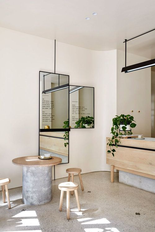 dining, marble floor, white wall, mirror, wooden round table, wooden stools, wooden island