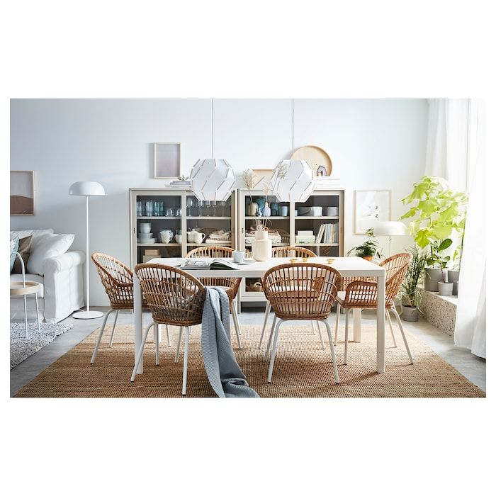 dining room, white floo, brown ug, white wooden dining table, brown rattan chairs, white pendant, shelves