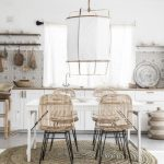 Dining Room, White Floor, Rattan Round Rug, White Wall, White Lantern, White Wooden Table, Rattan Chairs