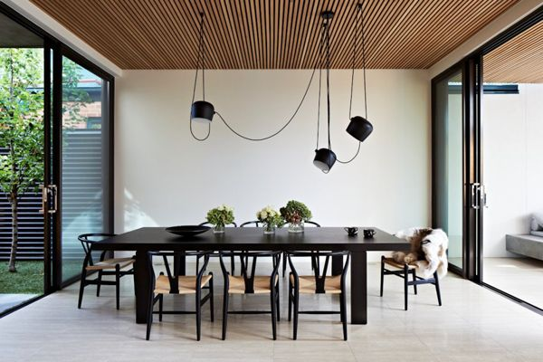 dining room, white floor, white wall, black dining table, black chairs, black pendants