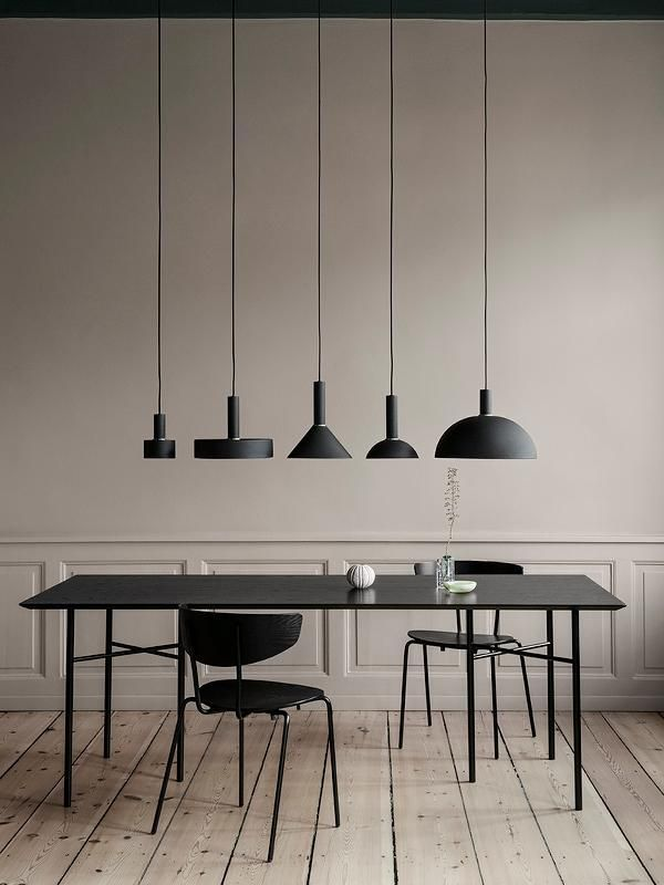 dining room, wooden floor, white wall, white wainscoting, black pendants, black dining table, black chairs