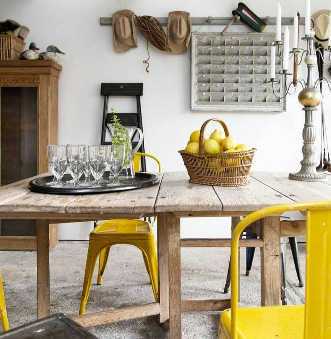 dining room, wooden table, yellow chairs, white wall,