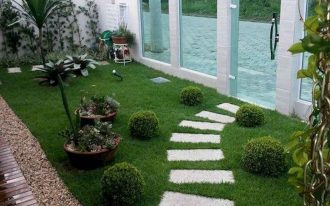 front yard, grass, white step stone, plants, stones, blue shade glass