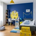 Kid Room, Wooden Floor, Blue Wall, White Wall, Grey Bed Platform, White Study Table, White Modern Chair, White Shelves, Yellow Round Accent Wall, Yellow Pendant