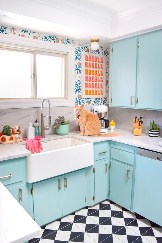 kitchen, blue cabinet, white top, white apron sink, patterned wall, white marble backsplash