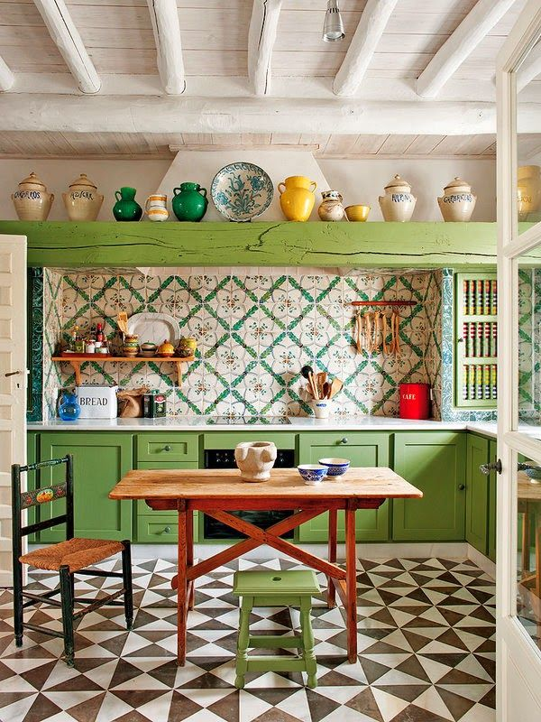 kitchen, patterned geometrical floor tiles, white wooden ceiling, green wooden cabinet, green patterned backsplash, wooden table, wooden stool