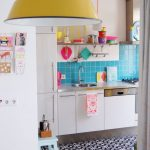Kitchen, White Cabinet Patterned Floor, Blue Backsplash, Yellow Pendant, Pink Chair