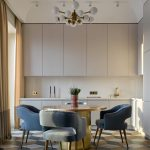Kitchen, White Smooth Cabinet, White Backsplash, Geometrical Floor Tiles Round Dining Table, Blue Chairs, Modern Chandelier