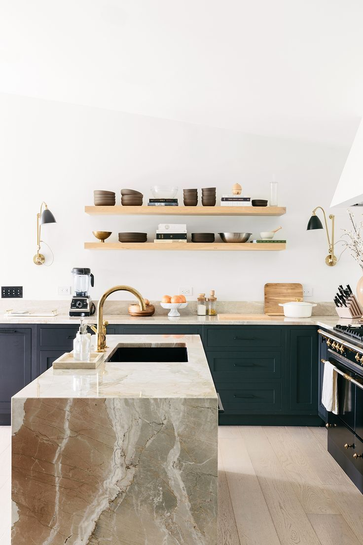 kitchen, wooden floor, white wall, dark green cabinet, marble island, wooden floating shelves,