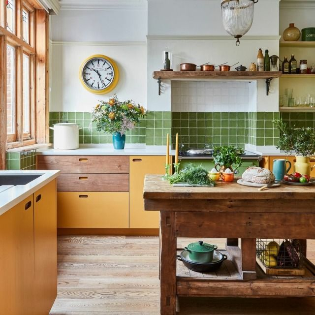 kitchen, wooden floor, white wall, white wall tiles, green wall tiles, yellow cabinet, wooden drawer, wooden island table, wooden floating shelves
