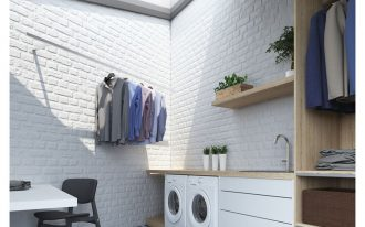 laundry room, patterned floor, white brick exposed wall, white cbainet, wooden cabinet, sink, hanging rod