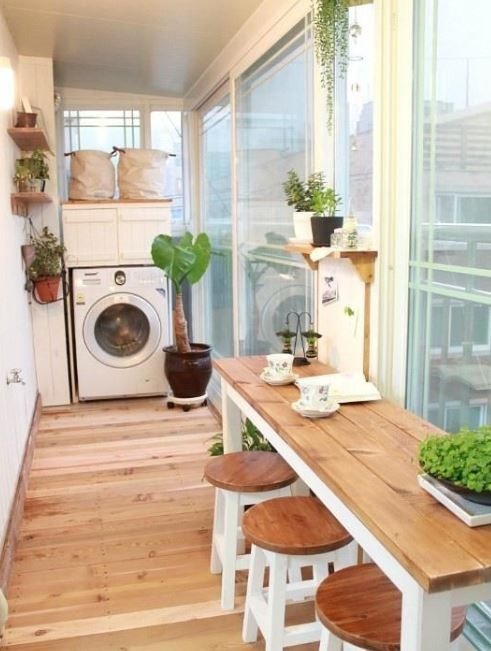 laundry room, wooden floor, white wall, glass wall, wooden table, wooden stools