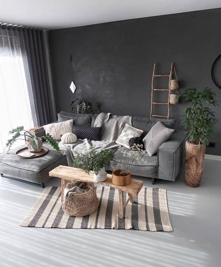living room, black wall, grey sofa, white seamless floor, wooden bench, wooden pot